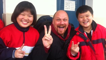Nehemia Gordon with two of his high school students he taught Hanukkah to in China.