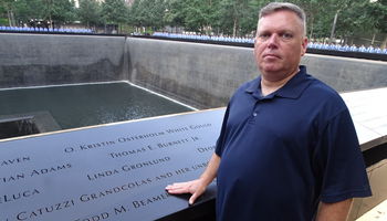 David Brink standing in front of the name of Todd M. Beamer, who stopped the terrorists from crashing Flight 93 into Washington DC.