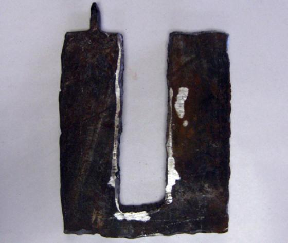 Art created by David Brink out of steel from the ruins of the towers. This piece depicts the Twin Towers. Detective Brink gave many of his art pieces to families whose loved one's remains were never recovered from Ground Zero. - Photo Courtesy of 9/11 Memorial Museum
